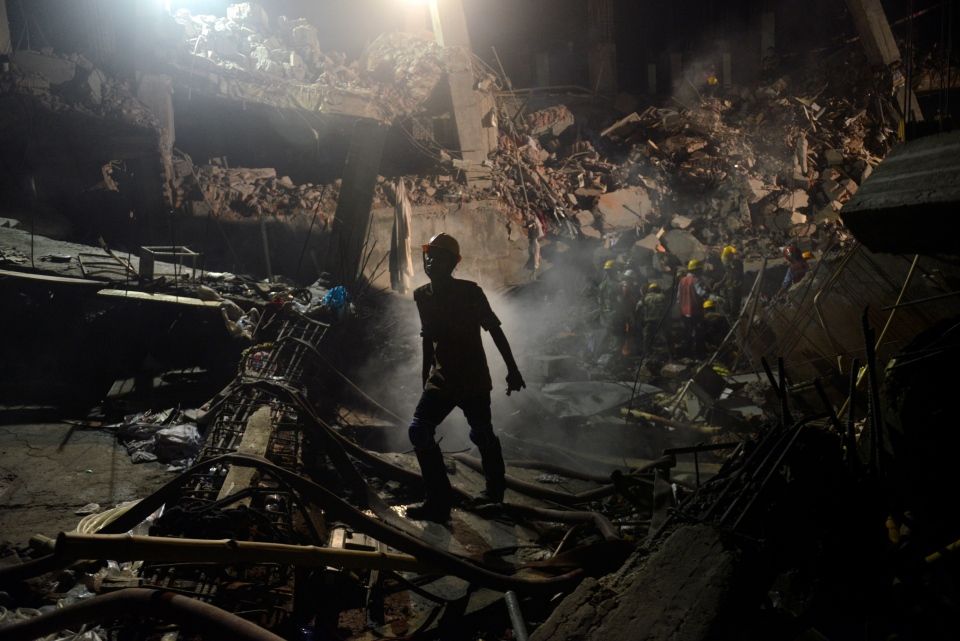 A worker leaves the site where a garment factory building collapsed near Dhaka, Bangladesh Monday, April 29, 2013. (AP / Ismail Ferdous)