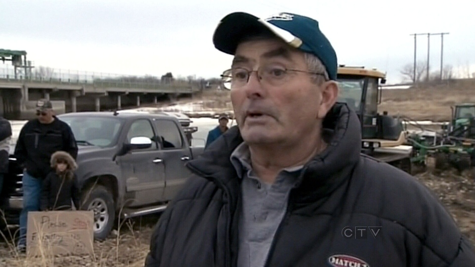 Joe Johnson from the Lake Manitoba Flood Rehabilitation Committee was one of several people who gathered in protest of flood water diversion near Portage la Prairie, Manitoba, Monday, April 29, 2013.