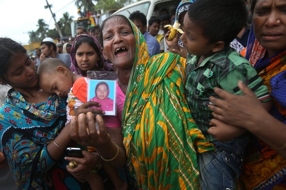 A woman grieves for her daughter-in-law who was trapped in the collapsed garment factory building on Tuesday 30, April, 2013 in Savar, near Dhaka, Bangladesh. (AP / Wong Maye-E)
