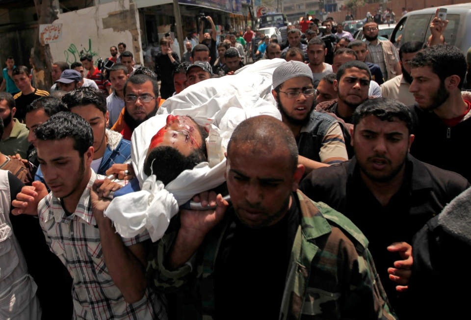 Palestinians carry the body of Haitham Mishal, 29, during his funeral at the Shati refugee camp in Gaza City, Tuesday, April 30, 2013. (AP / Hatem Moussa)