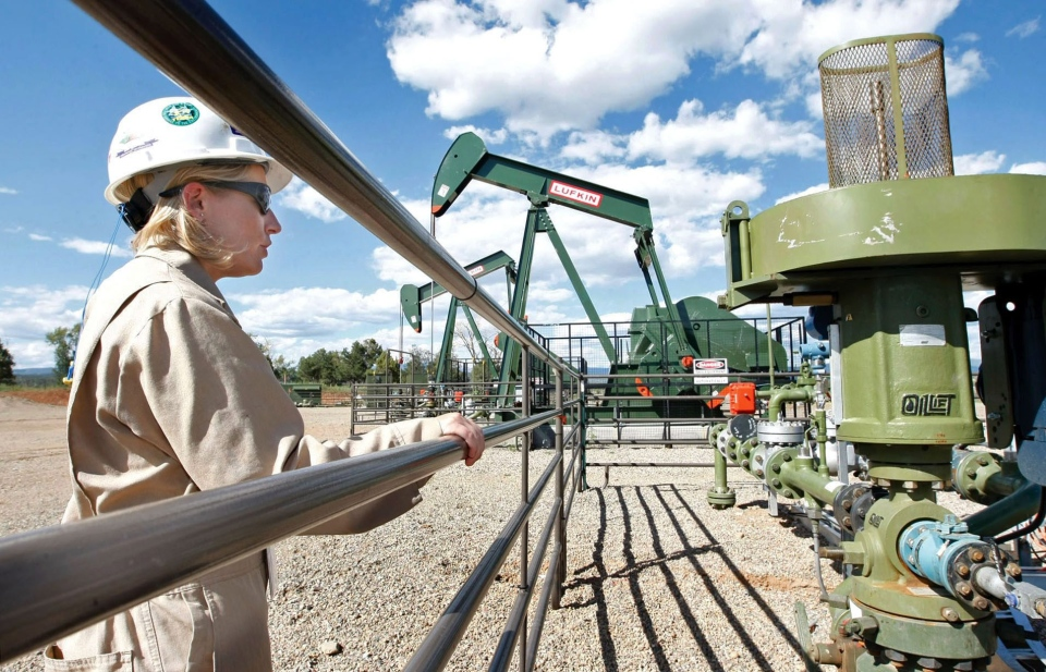Kourtney Hardwick, BP Florida operations manager, looks over a methane gas well site east of Bayfield, Colo., in this 2009 file photo. (AP Photo/Jerry McBride)