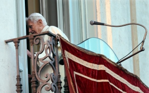 In this Feb. 28, 2013 file photo, Pope Benedict XVI leaves after greeting the faithful from the balcony window of the papal summer residence of Castel Gandolfo. (AP Photo/Alessandra Tarantino, file)