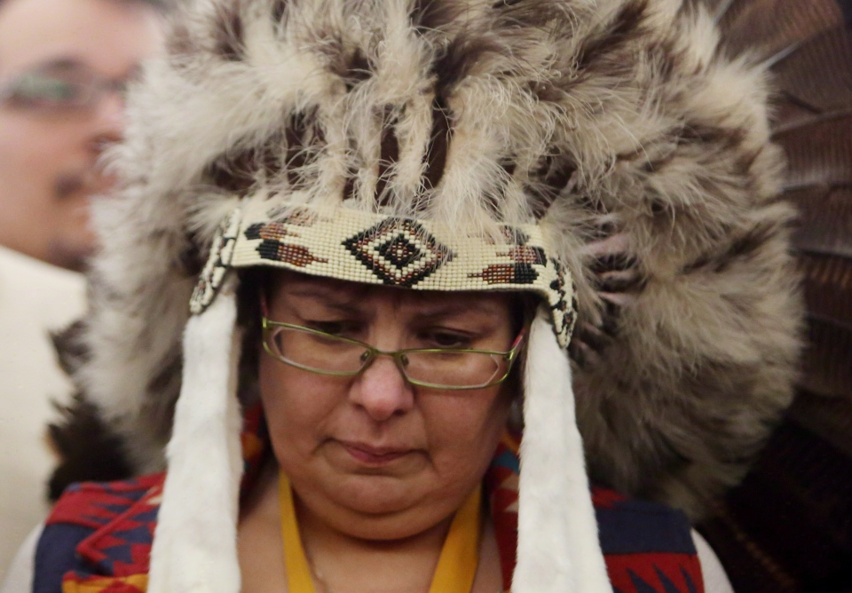 Attawapiskat Chief Theresa Spence takes part in a drum ceremony before departing an Ottawa hotel to attend a ceremonial meeting at Rideau Hall with Gov. Gen. David Johnston in Ottawa on January 11, 2013.  (Fred Chartrand / THE CANADIAN PRESS)