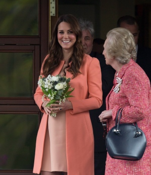 Being six-months pregnant is certainly not slowing down the Duchess of Cambridge. Despite her growing baby bump, Kate continues on with her royal duties -- smiles and all. <br><br>Kate, Duchess of Cambridge looks out at school children after an official visit to Naomi House near Winchester, England, Monday, April, 29, 2013. (AP / Alastair Grant)