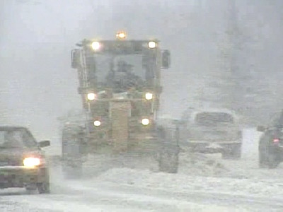 A snowplow tries to keep up with the falling snow on Edmonton roads on Monday, April 21, 2008.