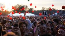 Fans listen as Phoenix performs at the Bonnaroo Music and Arts Festival on Sunday, June 13, 2010 in Manchester, Tenn. (AP / Mark Humphrey)