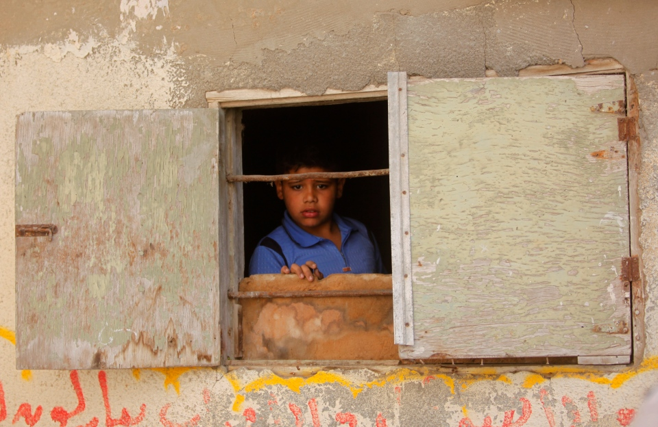 A Palestinian child watches the funeral procession of Haitham Mishal, 29, in the Shati Refugee Camp in Gaza City, Tuesday, April 30, 2013. (AP / Hatem Moussa)