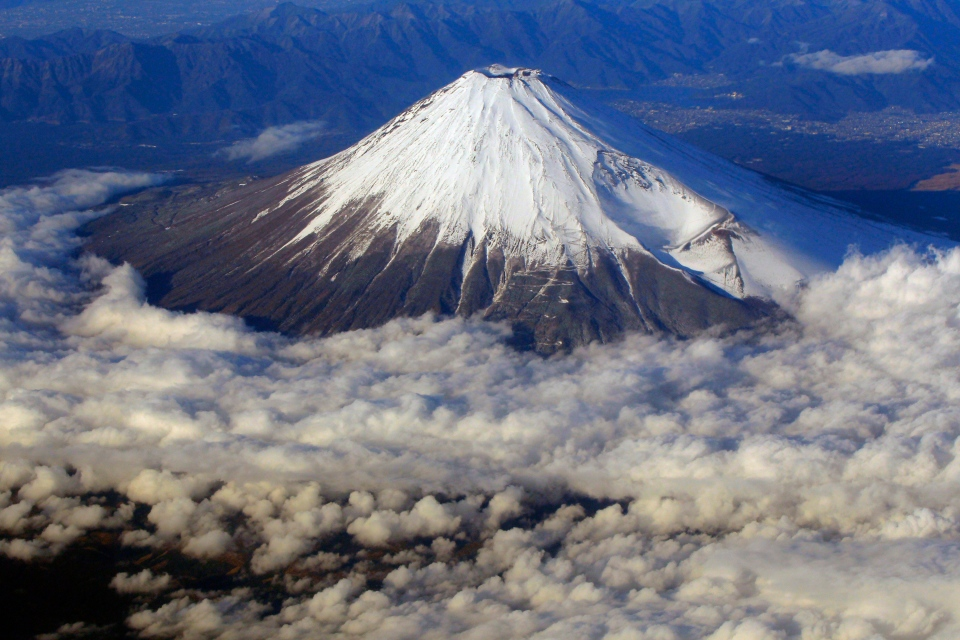 Snow-covered Mount Fuji, Japan's highest peak at 3,776-metre, is seen from an airplane window, Wednesday, Dec. 8, 2010.(AP Photo/Itsuo Inouye)
