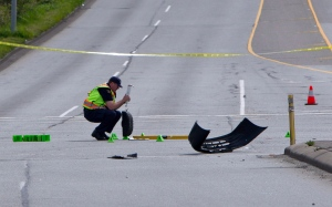 Police investigate the aftermath of a car cars at the intersection of 176th Street and 32nd Avenue in Surrey, B.C. on Sunday, April 28, 2013 where there were multiple fatalities. (Eric Dreger / THE CANADIAN PRESS)