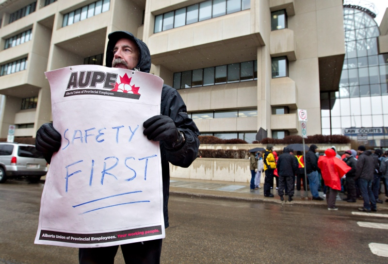 Alberta sheriffs take part in a strike as they joined correction guards, setting up a picket line outside the Edmonton courthouse in Edmonton, Alberta on Monday April 29, 2013.THE CANADIAN PRESS/Jason Franson