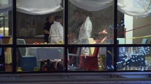 Vancouver police investigate the murder of Sandip Duhre, who was gunned down at a restaurant in the posh Wall Centre hotel on Jan. 18, 2012. (CTV)