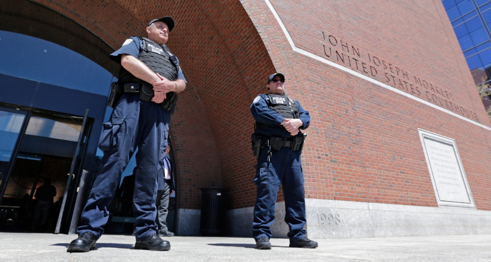 Department of Homeland Security police officers stand watch outside the Moakley Federal Courthouse in Boston, Mass., Wednesday, May 1, 2013. Three suspects were taken into custody in the Boston Marathon bombing case including two college friends of Dzhokhar Tsarneav, according to officials. (AP / Charles Krupa)