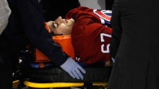 Montreal Canadiens' Max Pacioretty is wheeled away on a stretcher after taking a hit by Boston Bruins' Zdeno Chara during second period NHL hockey action Tuesday, March 8, 2011 in Montreal. (Paul Chiasson / THE CANADIAN PRESS)