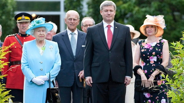 Queen Elizabeth, the Duke of Edinburgh, Prime Minister Stephen Harper and his wife Laureen arrive at a garden party at Rideau Hall in Ottawa, Wednesday June 30, 2010. (Adrian Wyld / THE CANADIAN PRESS)