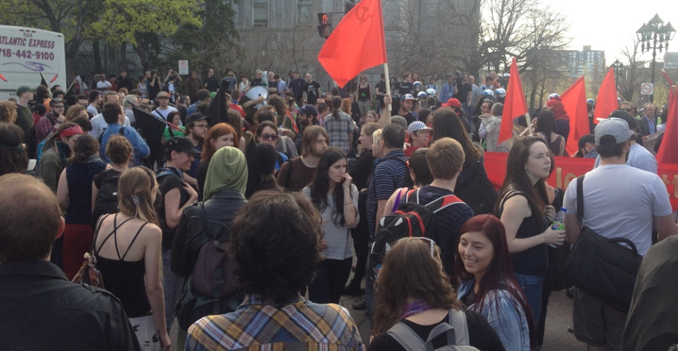 Anti-capitalist protesters gather at Montreal's city hall for a May Day march.