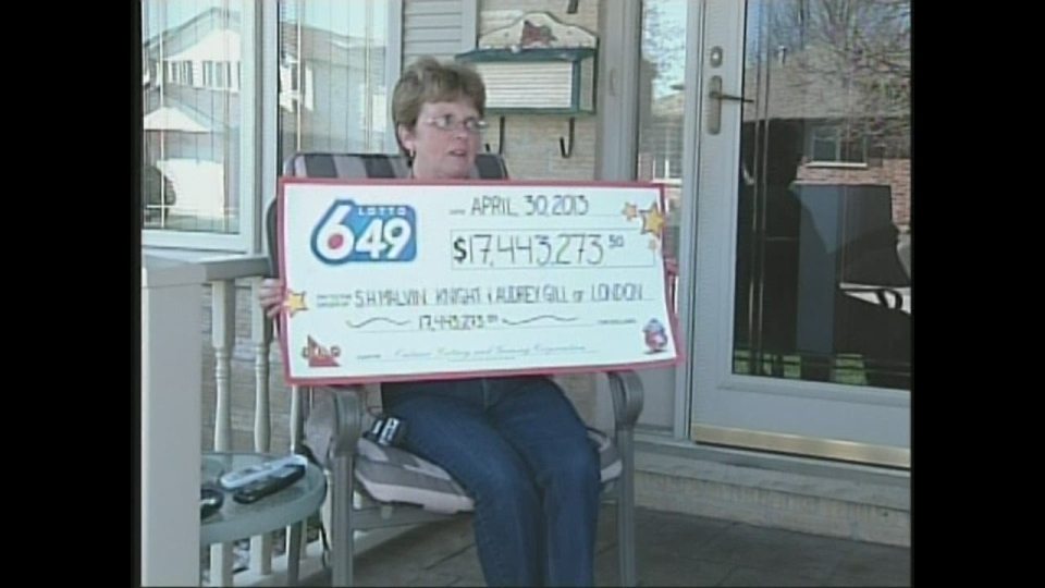 Audrey Gill holds up the cheque from the Ontario Lottery and Gaming Corporation in London, Ont. on Tuesday, May 1, 2013.