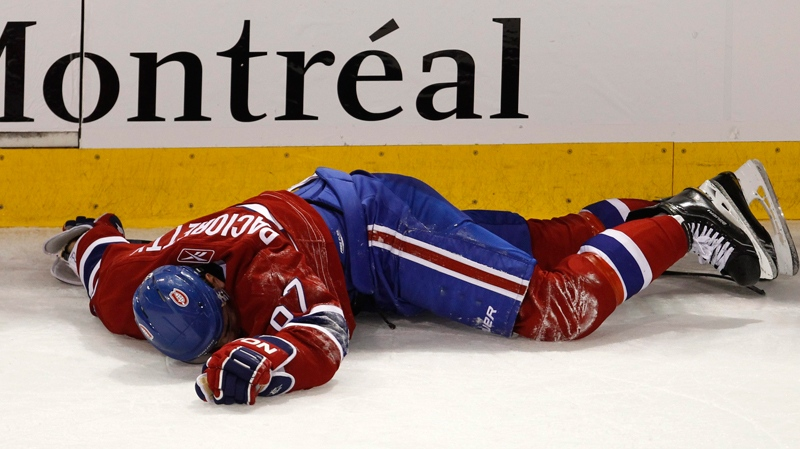 Montreal Canadiens' Max Pacioretty lays on the ice after taking a hit by Boston Bruins' Zdeno Chara during second period NHL hockey action Tuesday, March 8, 2011 in Montreal. (Paul Chiasson / THE CANADIAN PRESS)