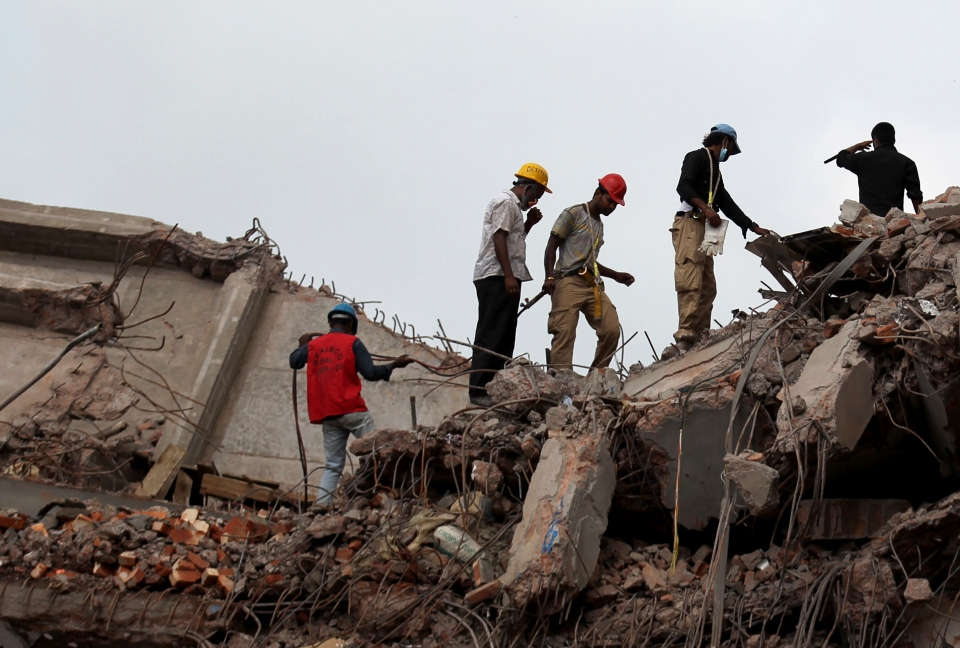 Workers and army personnel toil in the collapsed garment factory building in search for bodies on Thursday, May 2, 2013. (AP / Wong Maye-E)