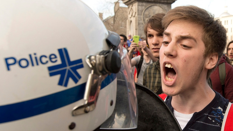 A protester yells at a police officer during a May Day anti-capitalist demonstration Wednesday, May 1, 2013 in Montreal.THE CANADIAN PRESS/Ryan Remiorz