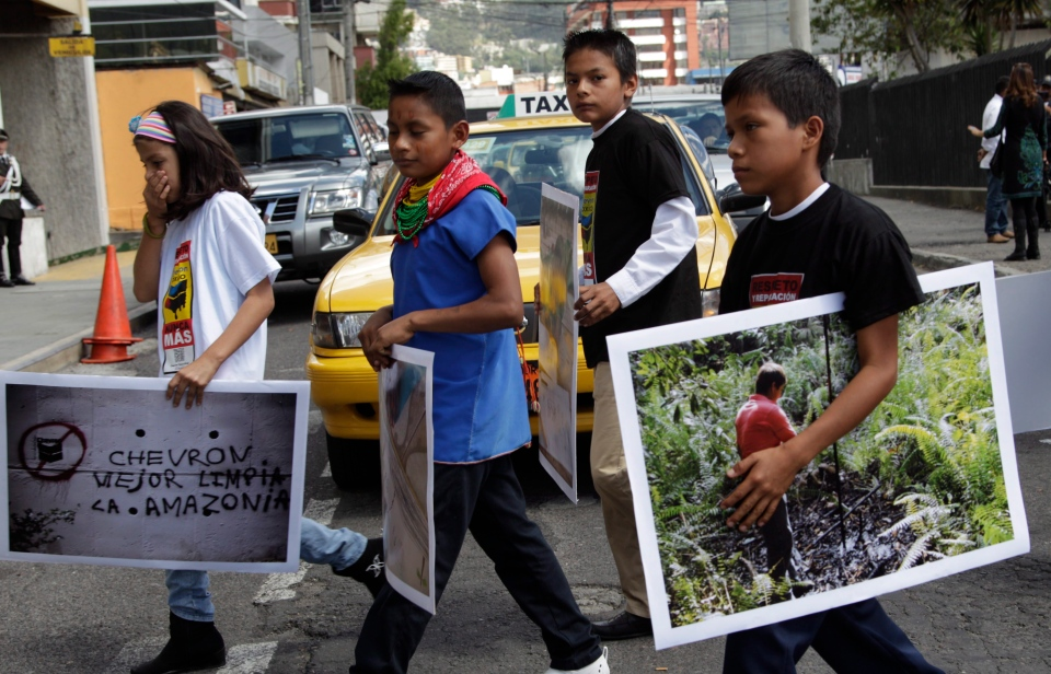 Children from the Amazonian region make their way into the National Court during a protest against Chevron, in Quito, Ecuador, Thursday, May 31, 2012. (AP / Dolores Ochoa)