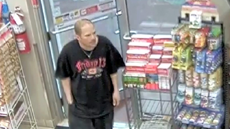 Security camera image of suspect sought in Canadian Tire gas bar robbery in Cambridge on Thursday, May 2, 2013 provided by Waterloo Regional Police.