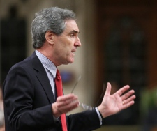 Liberal Leader Michael Ignatieff gestures during question period in the House of Commons on Parliament Hill in Ottawa on Thursday, March 10, 2011. (Sean Kilpatrick / THE CANADIAN PRESS)