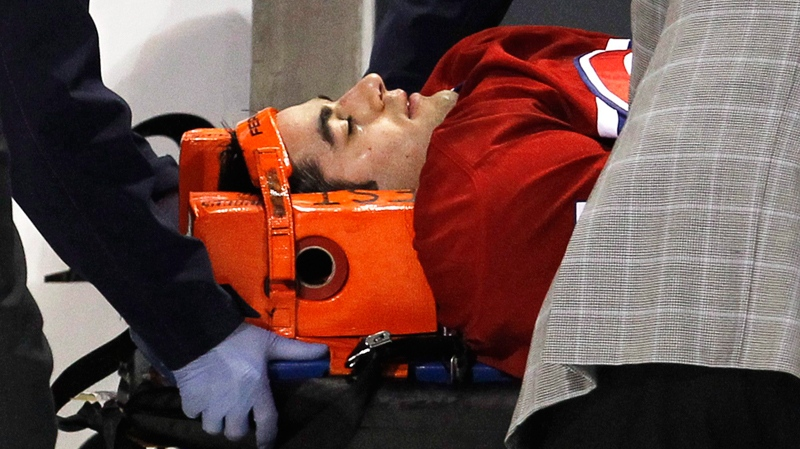 Montreal Canadiens' Max Pacioretty is wheeled away on a stretcher after taking a hit by Boston Bruins' Zdeno Chara during second period NHL hockey action Tuesday, March 8, 2011 in Montreal.(Paul Chiasson / THE CANADIAN PRESS)