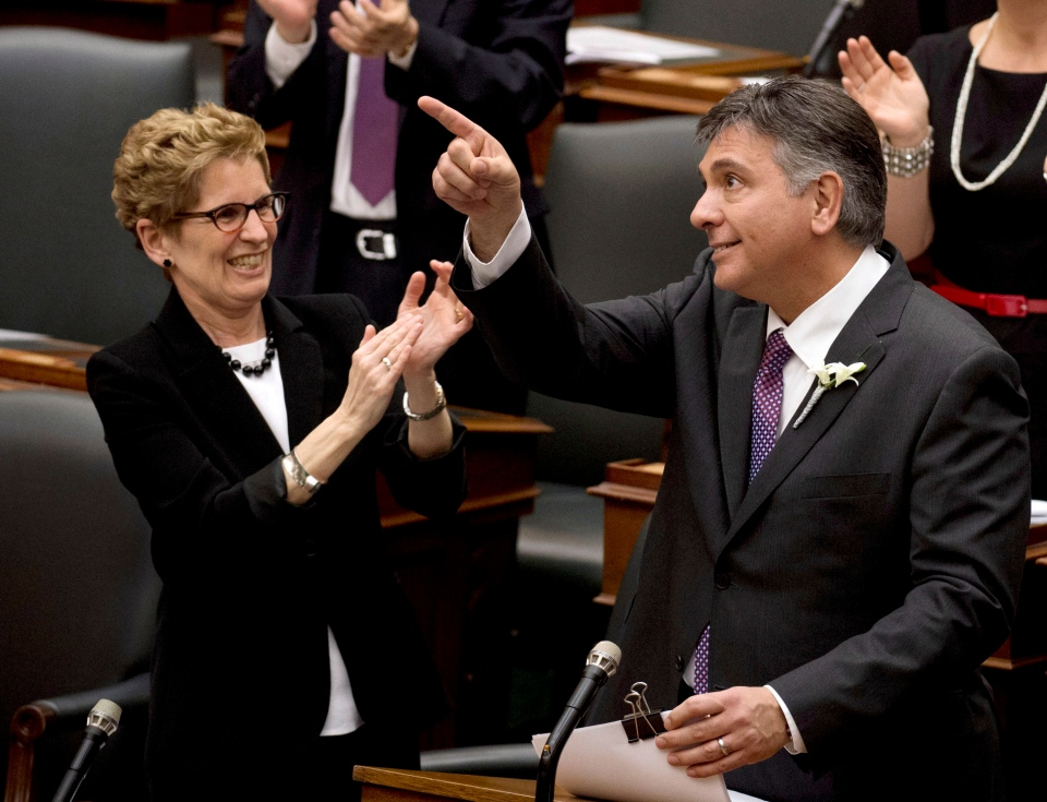 Ontario Premier Kathkleen Wynne applauds as Finance Minister Charles Sousa tables the 2013 provincial budget at Queen's Park in Toronto on Thursday, May 2, 2013. (Nathan Denette / THE CANADIAN PRESS)