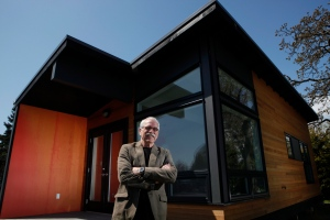 A modern looking home in Victoria, B.C.can fit into most backyards for under $100,000. Take a peek inside the 400 sq. ft. home. <br><br>Dan Boot, designer and developer for Small Modern Living Inc., stands outside a 400 sq. ft. home at the Westbay Marina in Victoria, B.C. The home offers features such as granite counter tops, glass tiles, engineered wood flooring, high efficiency washer and dryer, a living room area, kitchen, bathroom wall bed and a drop down desk. (Chad Hipolito / THE CANADIAN PRESS)