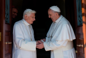 Pope emeritus Benedict XVI, left, is welcomed by Pope Francis as he returns at the Vatican from the pontifical summer residence of Castel Gandolfo, 35 km South-East of Rome, Thursday, May 2, 2013. (AP Photo / Osservatore Romano)