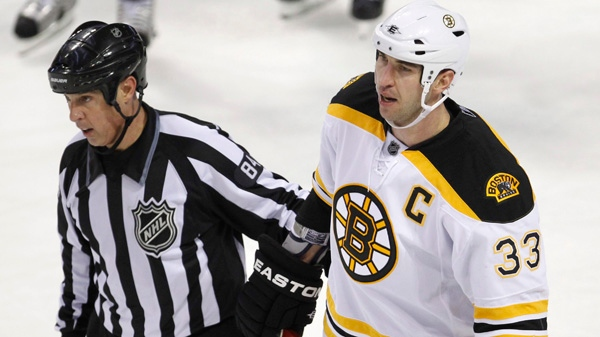 Boston Bruins' Zdeno Chara skates off the ice after hitting Montreal Canadiens' Max Pacioretty during second period NHL hockey action Tuesday, March 8, 2011 in Montreal. THE CANADIAN PRESS/Paul Chiasson