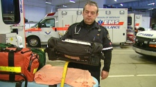 Paul Stack, an advanced care paramedic, checks his equipment in Kitchener, Ont. on Thursday, March, 9, 2011.