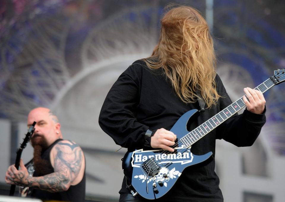 Guitarist Jeff Hanneman (right) of the American metal band Slayer perform in Warsaw, Poland in this June 2010. (AP Photo/Alik Keplicz)