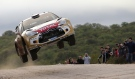 Rally cars soar through the air and slide through the mud at the FIA WRC Argentina Rally in Las Bajadas, Cordoba. Sebastien Loeb, from France, and co-driver Daniel Elena, from Monaco, claim victory at the end of the grueling track. <br><br>