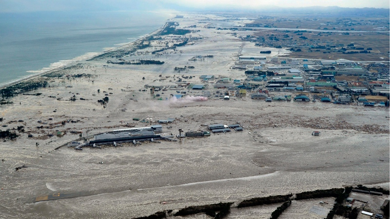 Earthquake-triggered tsunami sweeps the shore as Sendai Airport is surrounded by waters in Miyagi prefecture (state), Japan, Friday, March 11, 2011. The ferocious tsunami spawned by one of the largest earthquakes ever recorded slammed Japan's eastern coasts. (Kyodo News)
