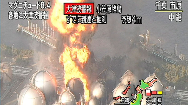 In this image taken from NHK television, a flame rises from petrochemical complex in Ichikawa, near Tokyo Friday, March 11, 2011. Japan was struck by a magnitude 8.9 earthquake off its northeastern coast Friday, unleashing a 4-meter tsunami that washed away cars and tore away buildings along the coast near the epicenter. (AP Photo/NHK)
