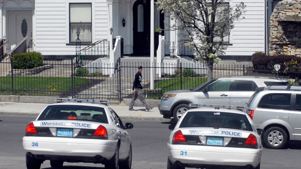 Police cars sit across from the Graham, Putnam and Mahoney Funeral Parlors, in Worcester, Mass., Friday, May 3, 2013. (The Telegram & Gazette)