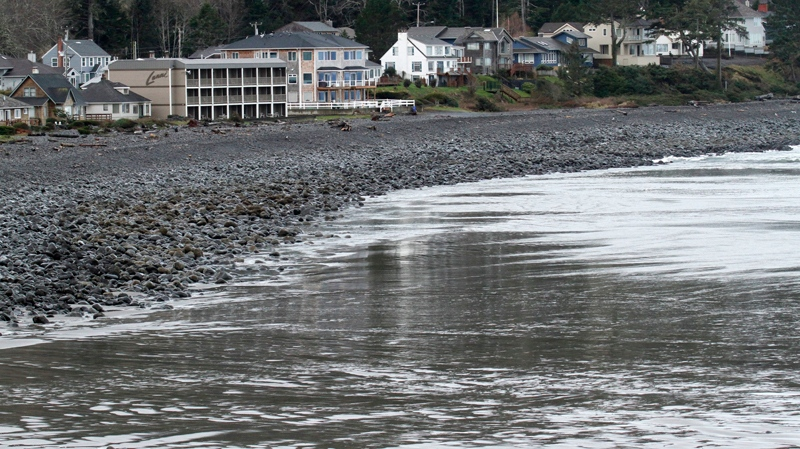 Bare beach is shown as the water recedes before a tsunami surge in Seaside, Ore., Friday, March, 11, 2011. The tsunami traveled across the Pacific Ocean after an 8.9-magnitude earthquake struck the east coast of Japan. (AP / Don Ryan)