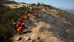 Wildfires are raging in Southern California, and more than 900 firefighters are working to control the blaze which spread quickly due to strong winds.<br><br>Crews work on the fire line after a wildfire near Point Mugu, Calif., Saturday, May 4, 2013. (AP / Ringo H.W. Chiu)
