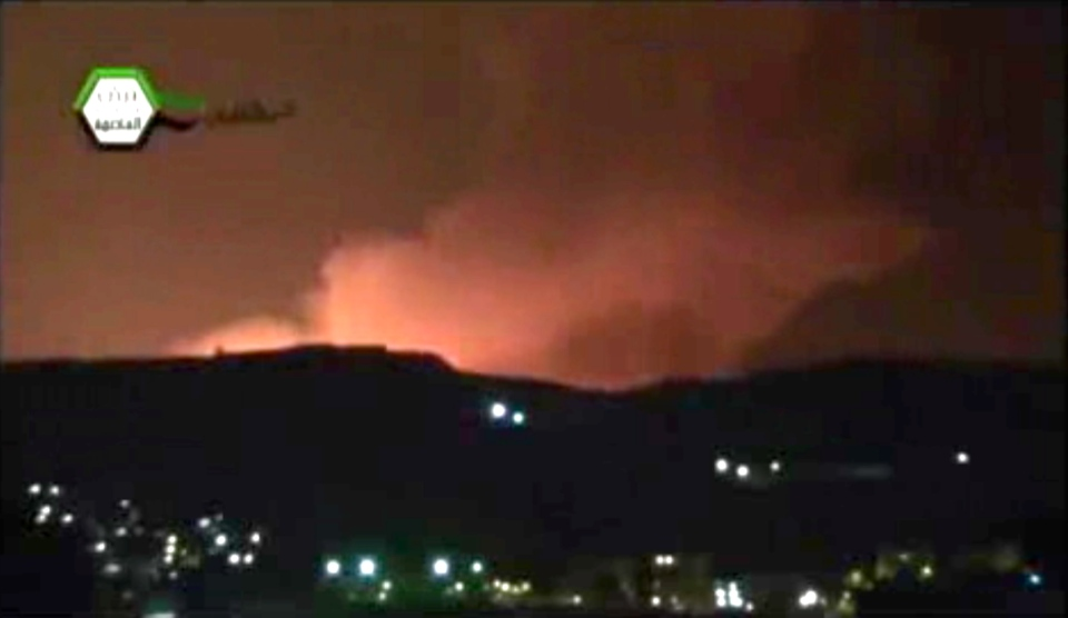 Smoke and fire fill the the skyline over Damascus, Syria, early Sunday, May 5, 2013 after an Israeli airstrike in this image taken from video obtained from the Ugarit News, which has been authenticated based on its contents and other AP reporting. (Ugarit News)