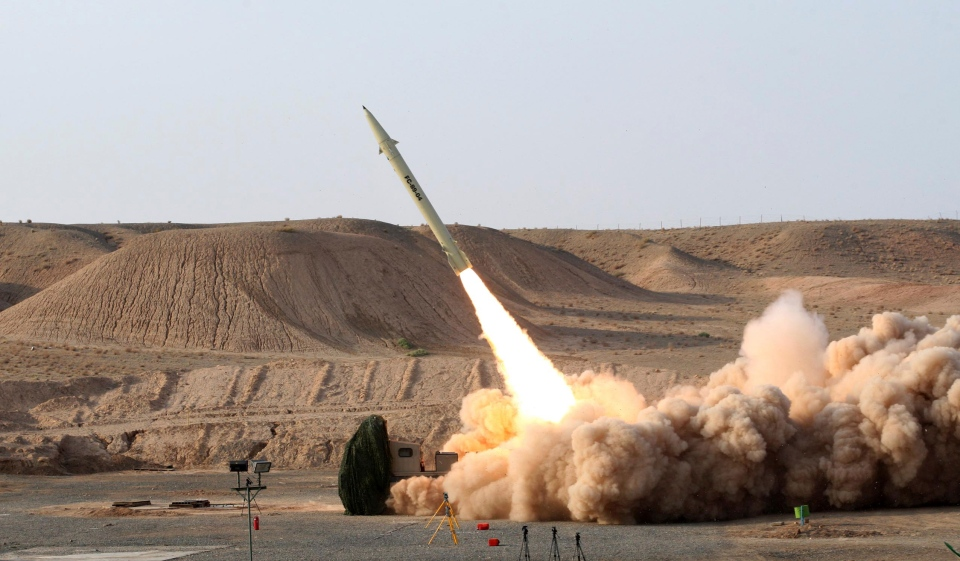 The launch of the Fateh-110 short-range surface-to-surface missile by Iranian armed forces, is seen at an undisclosed location.  (Iranian Defense Ministry / Vahid Reza Alaei)