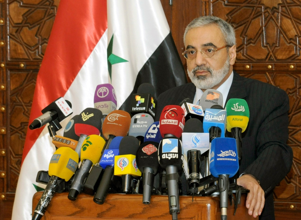 Syrian Information Minister Omran al-Zoubi speaks during a press conference in Damascus, Syria, Sunday, May. 5, 2013. (SANA)