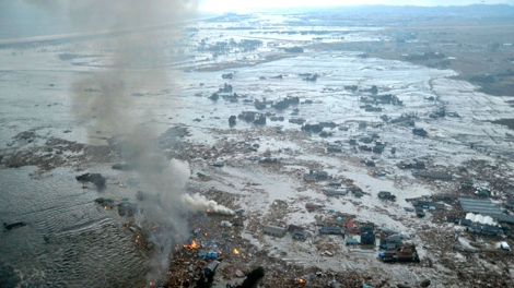 Shores are submerged in Natori city, Miyagi prefecture (state), Japan, after a ferocious tsunami spawned by one of the largest earthquakes ever recorded, slammed Japan's eastern coasts Friday, March 11, 2011. (Kyodo News)