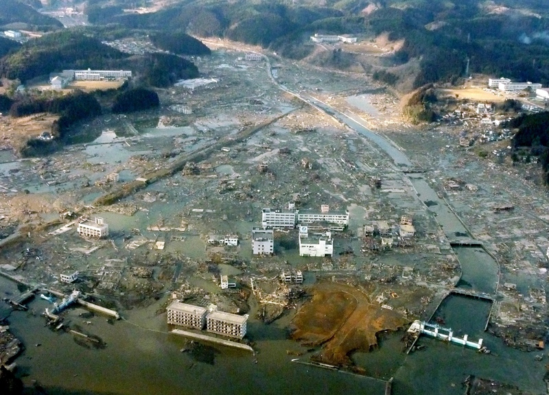 Minamisanriku town is submerged after the strong earthquake-triggered tsunami in Miyagi prefecture, northern Japan, Saturday, March 12, 2011. (Kyodo News)