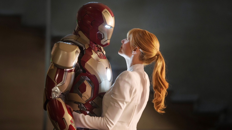 "Robert Downey Jr., left, as Tony Stark/Iron Man and Gwyneth Paltrow as Pepper Potts in a scene from ""Iron Man 3."" (AP / Disney, Marvel Studios)"