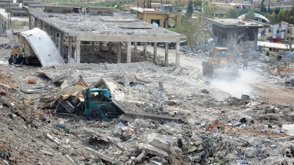 In this photo released by the Syrian official news agency SANA, damaged buildings wrecked by an Israeli airstrike are seen in Damascus, Syria, Sunday, May 5, 2013. (SANA)