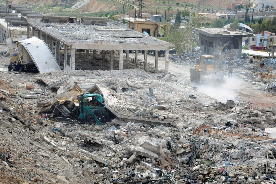 Damaged buildings wrecked by an Israeli airstrike are seen in Damascus, Syria, Sunday, May 5, 2013. (SANA)