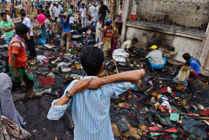 Bangladeshi people search for their belongings after the clashes between police and Islamic hardliners during a protest in Savar near Dhaka, Bangladesh, Monday, May 6, 2013. (AP / Ismail Ferdous)