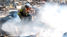 A resident is rescued from debris in Natori, Miyagi, northern Japan, Saturday, March 12, 2011. (AP / Asahi Shimbun, Noboru Tomura)