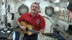Canadian astronaut Chris Hadfield plays the guitar from the International Space Station, Monday, May 6, 2013.
